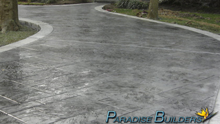 Stamped concrete driveway with dark grey and light grey accents
