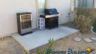 Concrete slab for bbq and smoker in a las vegas backyard