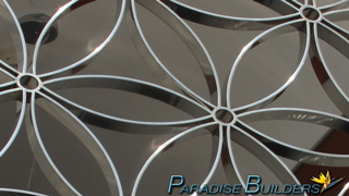 Artistic metalwork that is chrome plated in a symmetrical pattern