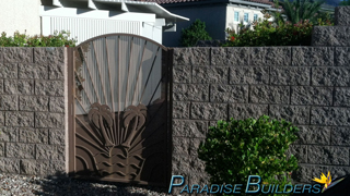 Custom palm tree decorated side entry gate in a las vegas backyard