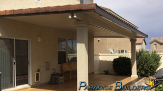 An insulated patio cover with stucco posts and tile trim in a north las vegas backyard