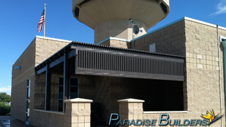 Brown lattice patio cover installed at the north las vegas airport control tower