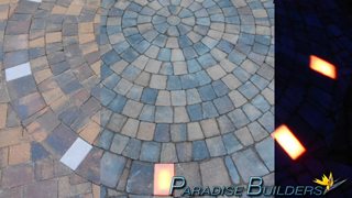 Day to night fade of a paver patio that features night lighting